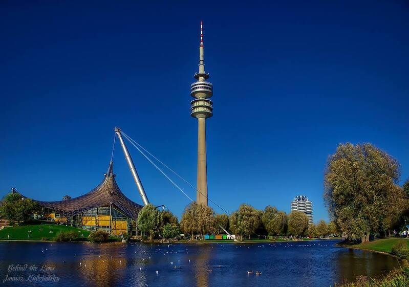 Der Olympiaturm und der Olympiasee München, © Der Olympiaturm und der Olympiasee - Bild: Janusz Lubojansky - Behind the Lens