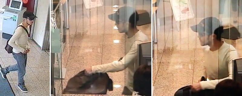 © Die Polizei sucht mit einem Foto nach diesem Mann, der in Augsburg eine Bank ausgeraubt haben soll.