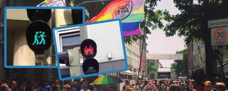 CSD in München mit Ampelmännchen und Regenbogen-Fahnen